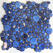 Ceramic mosaic tile with blue glazed irregular shape