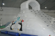 New Gaint inflatable water iceberg floating slide for water park with penguin printing