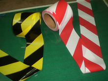 red and white caution tape