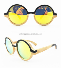 Nature Bamboo sunglasses stained with black color in revo gold lenses
