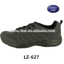 baratos nueva llegada de tejido de calzado deportivo de color negro para la venta caliente