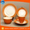 orange with white ceramic dinnerware set