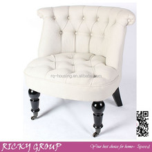 wing back white wooden chair