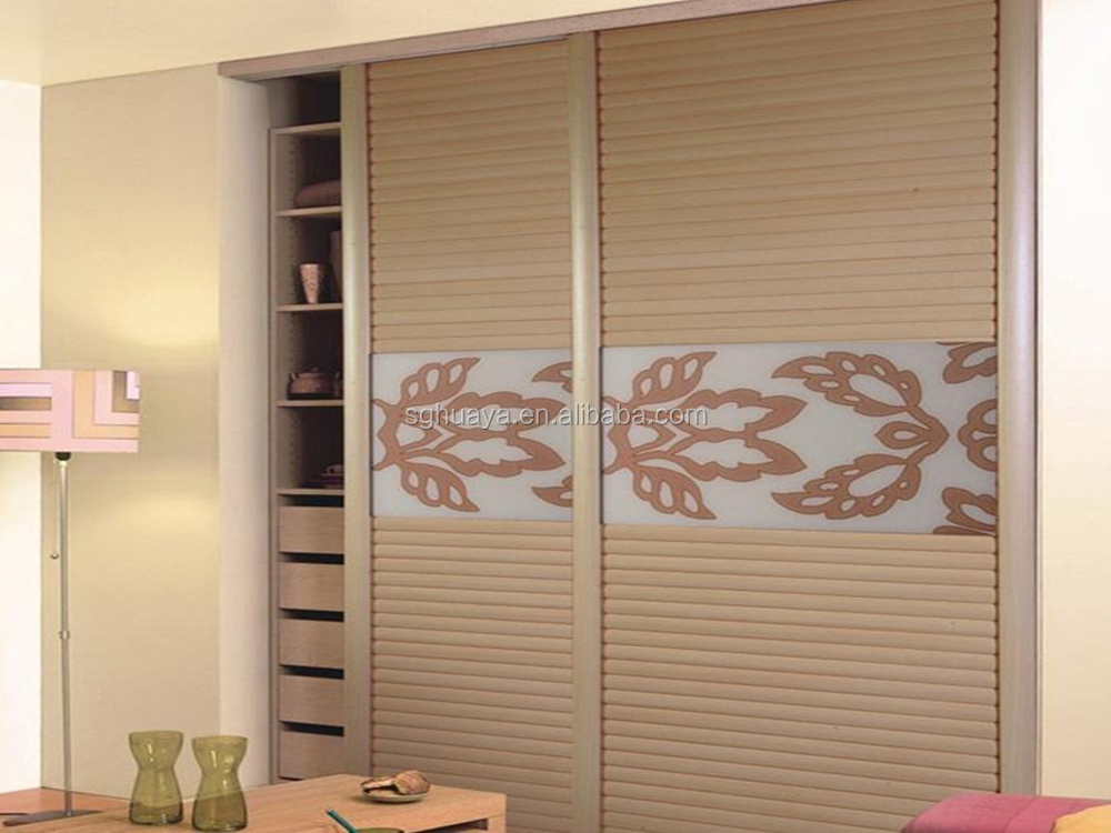Modern bedroom sliding door wardrobe design laminate for Contemporary wardrobe designs india