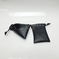 Black leather pouch with black rope