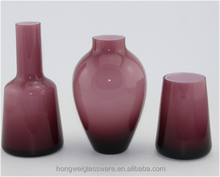 purple colored glass vase