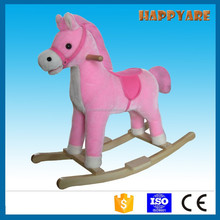 baby pink plush rocking horse toys with moving mouth and tail on wooden base