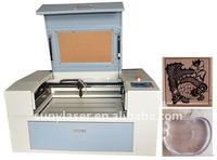 Hot-selling desktop acrylic laser cutting machine with auto up and down work table and red dot positioner(SUNY-640)