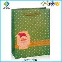OEM/ODM Factory Kraft Paper Christmas Decoration Handmade Polka Dot Paper Bags With Logo Print