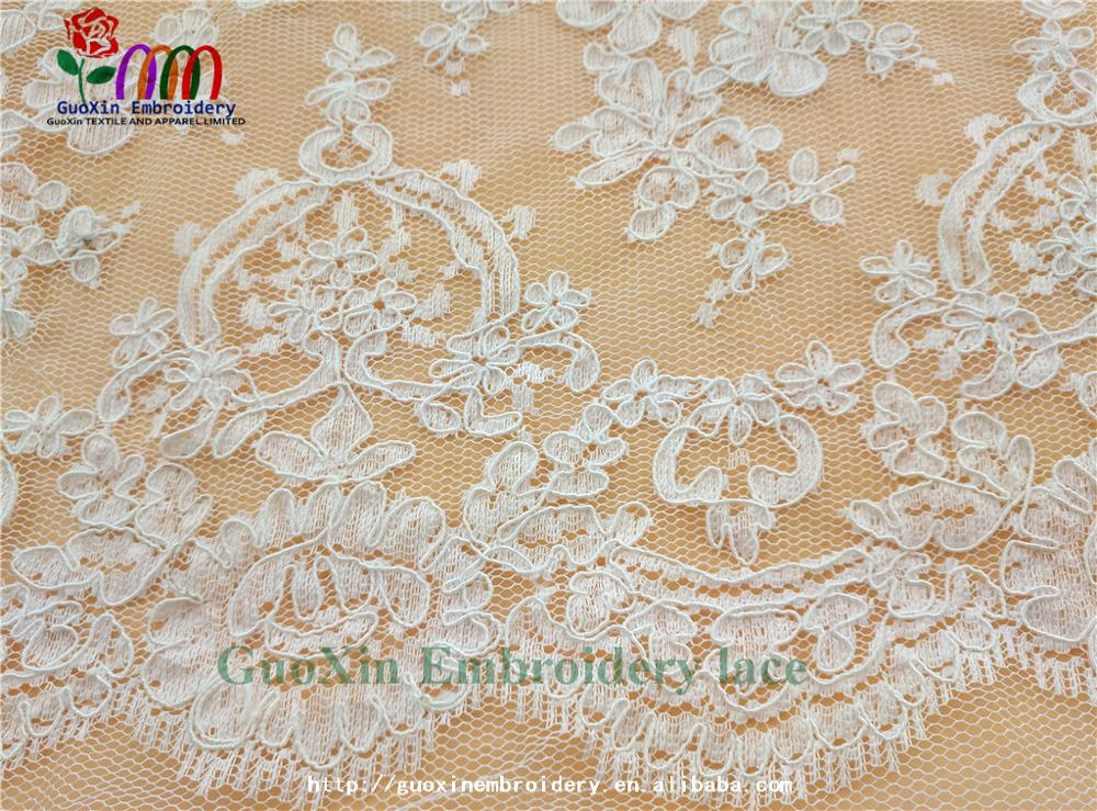 factory wholesale ivory embroidered french lace fabric with cording (6).jpg