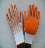 13 Gauge knitted, nylon liner, orange nitrile gloves