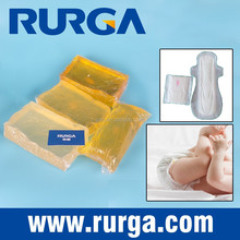 Disposable diaper with hygiene pressure sensitive hot melt construction adhesive