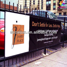 Outdoor installed to fence with zip ties advertising Mesh banner