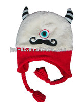 white coral velvet hat with red knitted earflap