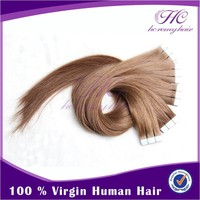 Alibaba new products curly skin weft tape hair extensions wavy curly style