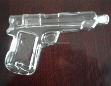 Pistol shaped beverage glass bottle for tequila and whiskey