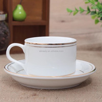 golden line ceramic coffee cup and saucer