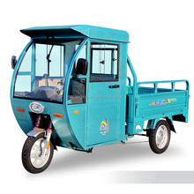 battery operated cargo tricycle with closed cabin