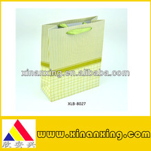 green art paper bag with stripes and chequers