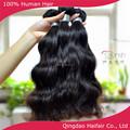 Natural de color negro brasileño virgen tejer del pelo humano de extensión, el pelo ondulado natural tramas en alibaba venta al por mayor