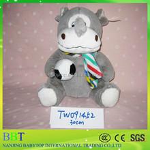 stuffed grey rhino with plush football in high quality material