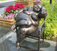 Nude fat female statue sitting on a chair enjoying life