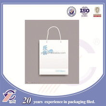 Simple design/ little white paper bags, cusom logo can be printed, free samples available