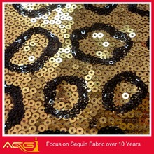 The hot sale top 100 design 100% polyester popular natural fancy sequin fabric sun reflective fabric