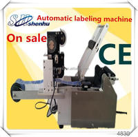 Low price automatic round bottle labeling machine,cold glue labeling machine