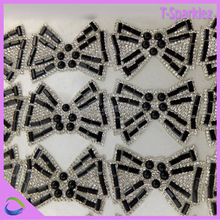 bow tie shape iron rhinestone sheet roll, hot fix glass crystal mesh for clothing