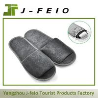 women folding travel slippers and traveling foldable slippers
