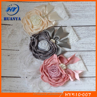 Latest fancy girls elastic soft lace fancy bow white feather piped fabric flower headband for kids