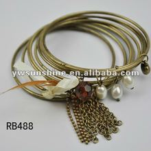 India copper bangles with pearl feather and macrame
