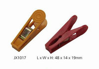 colored clothes hanger and clips , plastic peg
