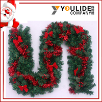 China New Style christmas decoration rattan PVC garland with redbow and red ribbon