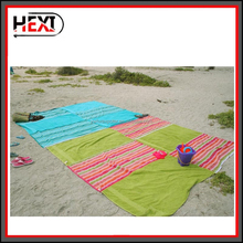 Raqpak Beach/Picnic Blanket, Light weight and Sand Proof with 4 Stakes