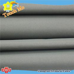 Rain protection fabric discharge printing
