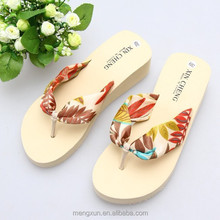 In the summer of 2014 classic han edition Bohemian women flip flops Silks and satins sponge thick bottom slope beach shoes
