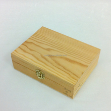 small unfinished wooden treasure chest storage box with metal lock pine