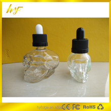 popular e liquid bottle 30ml SKULL head glass dropper bottle with childproof ca from bottle manufacturer in China
