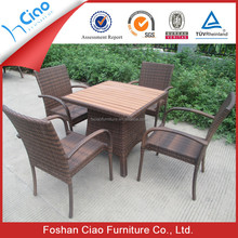 Outdoor rattan table with teak wood surface and 4 chairs