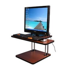 height adjustable computer desk,working with PC but standing in office