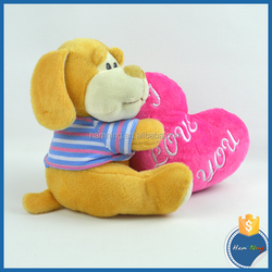 striped t-shirt and nylon rope dressed sitting hugging rose red heart dog toy