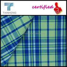 fashion design yellow isolated on blue background tartan plaid pattern yarn dyed cotton fabric for shirts