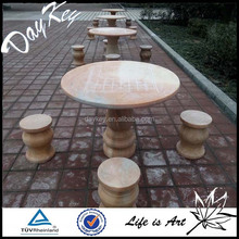 Outdoor stone tables and benches for garden