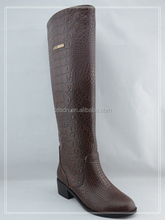 woman rubber flat thigh boots