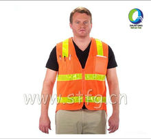 high visibility safety vest with pockets in orange color for construction use