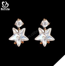White color stone star shape silver earring covering the ear