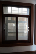 aluminum casement window type with wood and white color