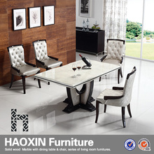 wooden dining table with marble top designs